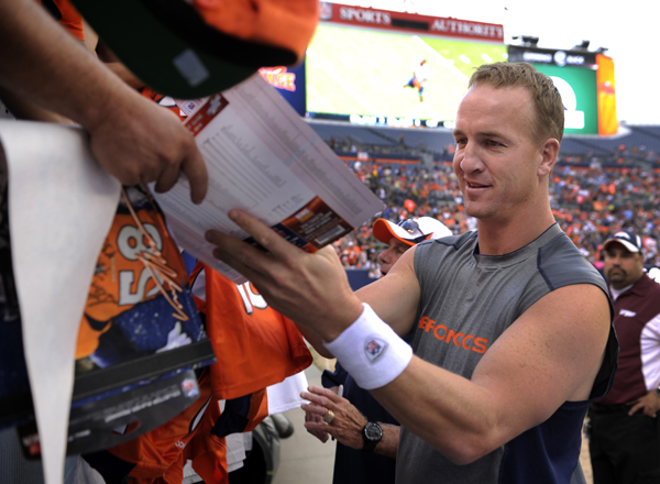 Manning signing autographs for fans