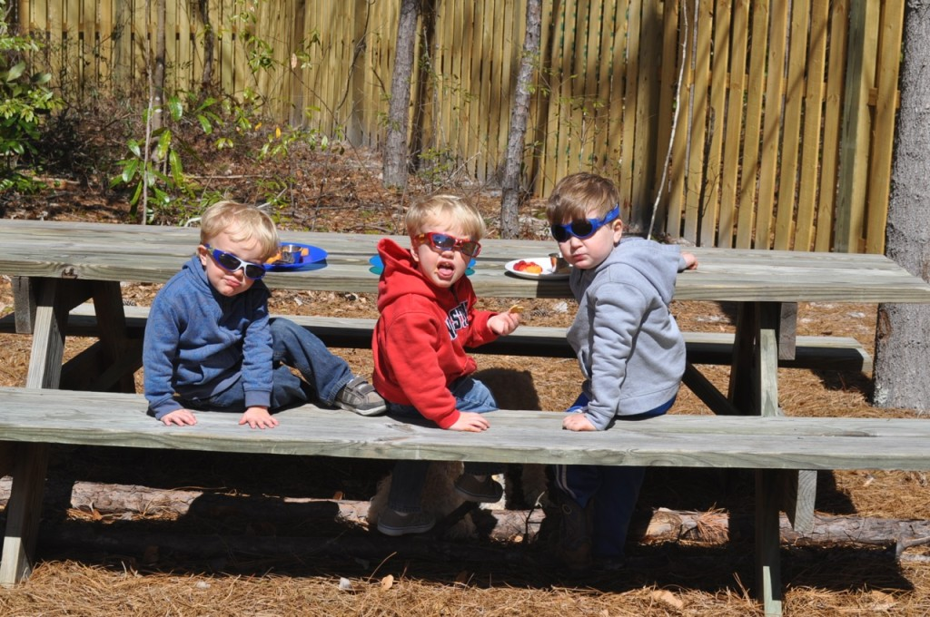 Our boys around Paw Paw's picnic table